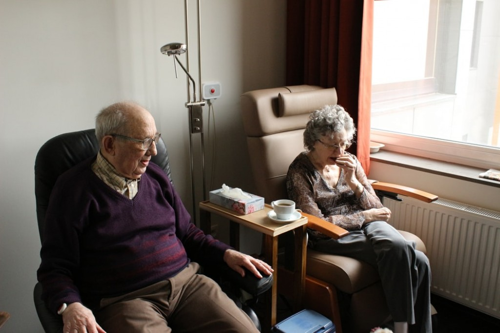 Senior man and woman sitting at home