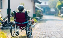 Woman sitting outside in a wheelchair