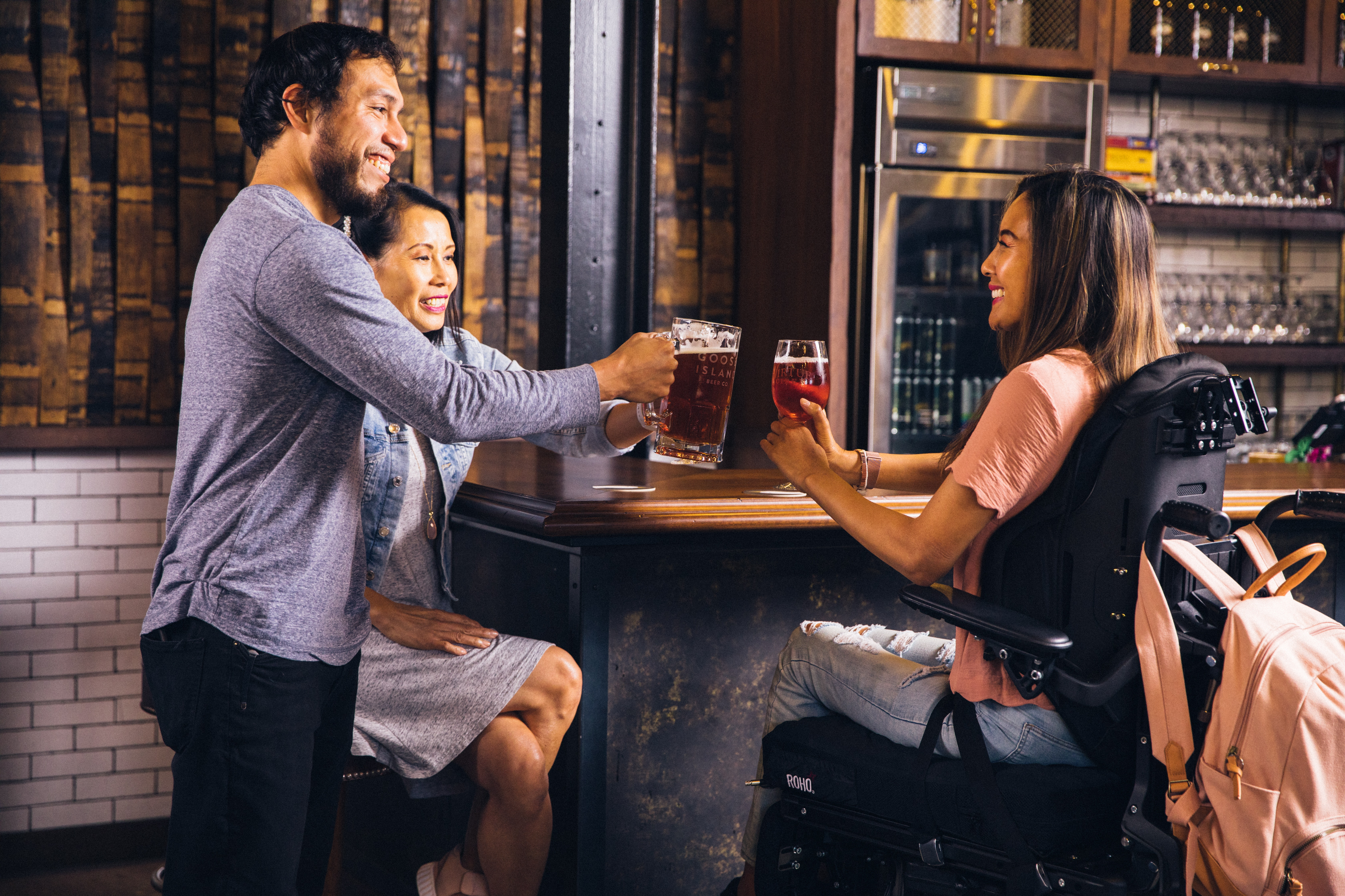 Woman in power chair socializing with friends
